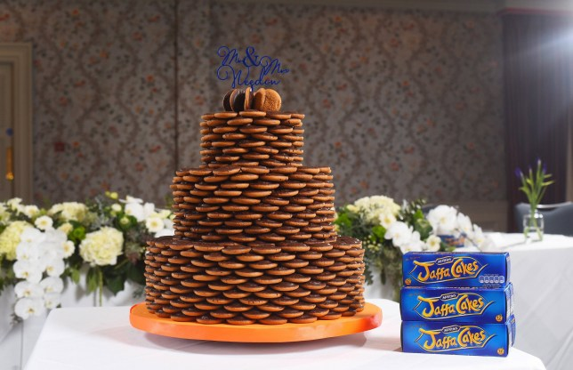 Pictured: The final Jaffa Wedding Cake A couple loved Jaffa Cakes so much they had a specially-made wedding cake covered with a thousand of them for their big day. Tristan and Maria Weedon's mutual love of the treats began 11 years ago when Tristan arrived for their first date with a packet of them - much to her amusement. Since then the couple, of Waltham Cross, Herts, estimate they have enjoyed around 4,000 of the tiny sponge cakes together - or 334 packets.SEE COPY FOR DETAILS © Solent News & Photo Agency UK +44 (0) 2380 458800