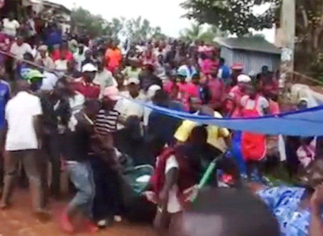 Pic shows: The couple being carried by other people.nnA pair of adulterous lovers were publicly shamed after getting stuck together having sex and being forced to shout for help.nnThe amorous couple were in the middle of an intimate tryst in the Daraja Mbili area of Kisii, western Kenya yesterday (Thursday).nnBut the man suddenly found himself unable to detach from his partner.nnUnable to control the pain that came with their embarrassing situation, both let out loud yells that attracted the neighbours.nnA crowd milled around the house and the two were carried outside on a sheet as more and more people gathered to see the shamed lovers, still locked together and draped only in more sheets.nnIt was reported in local media and widely believed that the woman¿s husband, suspecting she was cheating, had secretly given her a concoction prepared by a witch doctor.nnIt was designed to have the effect of making the lovers inseparable and proving their guilt.nnOn the husband¿s instructions, local media reported, the pair were taken to the witch doctor, who separated them.nnThe witch doctor made the man who was having sex with the married woman pay a fine before agreeing to free him.nnThe witch doctor also told local news that the incident should serve as a lesson to those cheating in relationships.nnLocal media said that infidelity was a prominent social problem in Kenya.nn(ends)