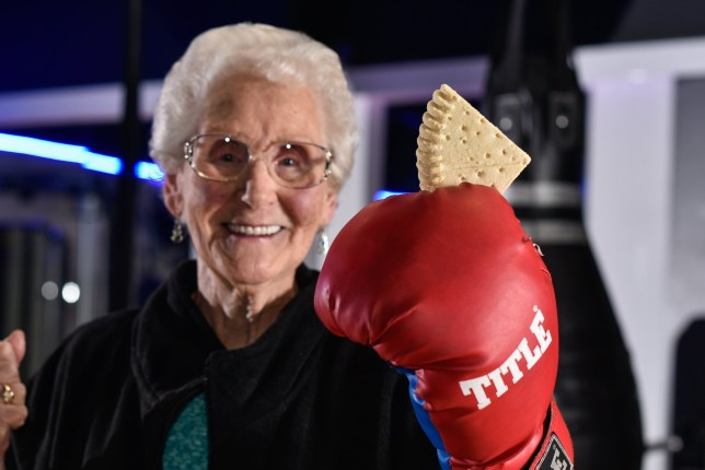Joyce Fox, 78, pays using shortbread for her time spent boxing at the gym in Hull, East Yorks., November 18 2016. See Ross Parry story RPYGRAN: This 87-year-old gran uses the gym four times a week - and even pays for her membership with SHORTBREAD. Super-fit Joyce Fox has a regular routine of 20 pull downs, ten minutes on the exercise bike and ten minutes on the hand bike. The super-gran even jumps in the ring and spars with personal trainer Chelsea Arnell, 26, who says the pensioner has even mastered the 'Ali Shuffle'. Grandmother-of-five Joyce catches the bus four times a week to train at Fit24 gym in Hull, East Yorks., and has not broken her routine since she started in May.