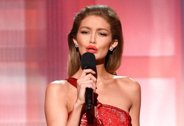 Mandatory Credit: Photo by Stewart Cook/REX/Shutterstock (7449730kf) Gigi Hadid does an impression on Melania Trump American Music Awards, Show, Los Angeles, USA - 20 Nov 2016