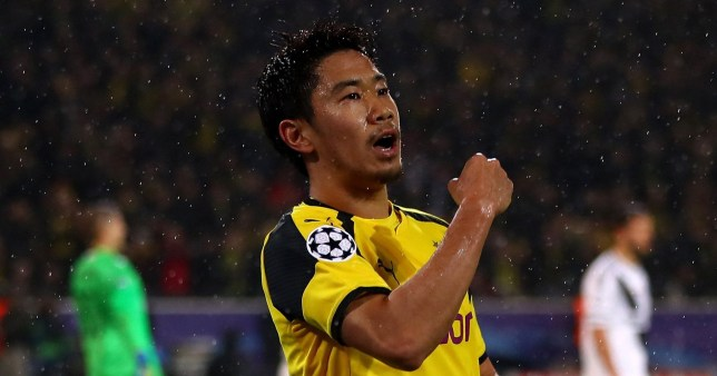 DORTMUND, GERMANY - NOVEMBER 22: Shinji Kagawa of Borussia Dortmund celebrates scoring his teams first goal during the UEFA Champions League Group F match between Borussia Dortmund and Legia Warszawa at Signal Iduna Park on November 22, 2016 in Dortmund, North Rhine-Westphalia. (Photo by Alex Grimm/Bongarts/Getty Images)