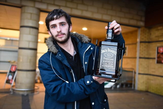 PIC BY MERCURY PRESS (PICTURED: A MORRISONS CUSTOMER IN SPEKE, LIVERPOOL, POSES WITH HIS NEWLY BOUGHT 3 LITRE BOTTLE OF JACK DANIELS - ON OFFER TODAY)