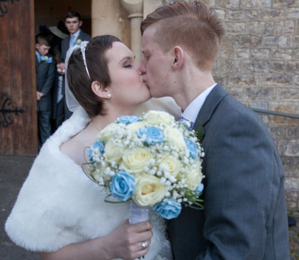 Amber and Callum Firks kiss outside of the church after the wedding, the school sweethearts got married after Amber was diagnosed with a terminal brain tumour, St Peter's Church, Bishopsworth, Bristol. 25 November 2016 See SWNS story SWWEDDING; A terminally-ill teenager married her childhood sweetheart yesterday (fri) after hundreds of people donated money to fund their dream wedding. Callum Firks, 17, got down on one knee after first love Amber Snailham, also 17, was told cancer in her diaphragm had spread to her brain. The loved-up school pals made the commitment after she revealed getting married was the top of her bucket list. Both families and the teens' pals set about organising a huge wedding in just a matter of weeks and raised more than £6,000 to fund the big day after strangers pitched in.