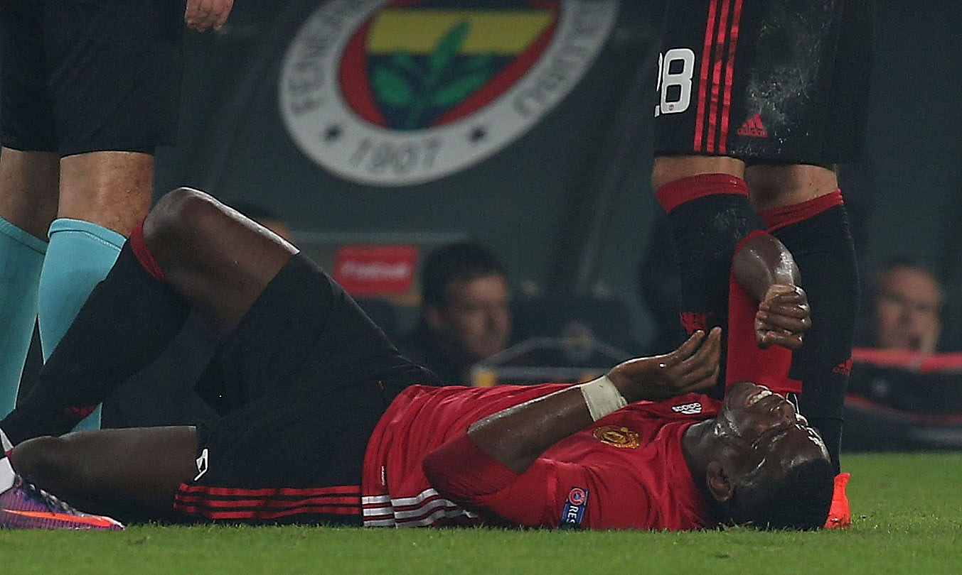 ISTANBUL, TURKEY - NOVEMBER 03:  Paul Pogba of Manchester United lies injured during the UEFA Europa League match between Manchester United and Fenerbahce at sukru Saracoglu Stadium on November 3, 2016 in Istanbul, Turkey.  (Photo by Matthew Peters/Man Utd via Getty Images)