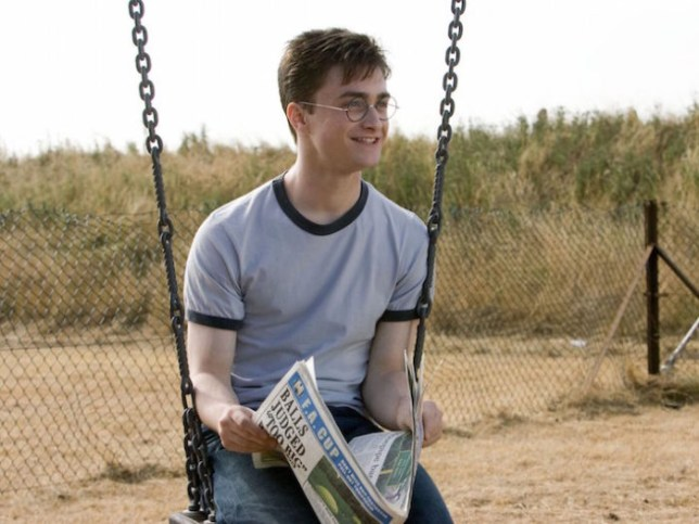 Harry is seen reading the paper in Order of the Phoenix (Picture: Warner Bros)