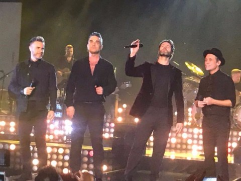 Robbie Williams sends fans into meltdown with Take That reunion during his own gig