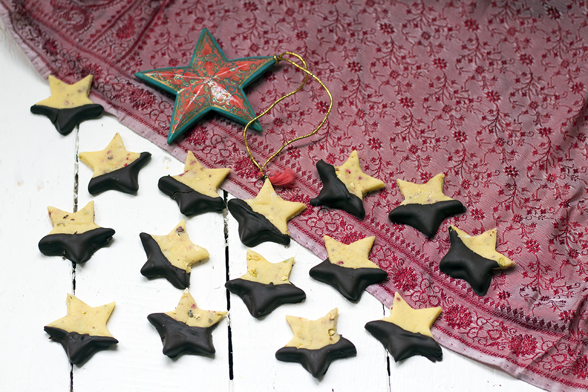 Christmas recipe video: Chocolate-dipped marzipan stars with pistachio and raspberries