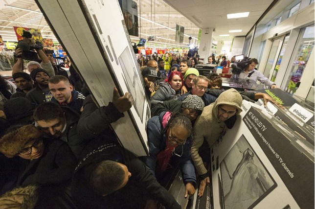 Mandatory Credit: Photo by Ray Tang/REX/Shutterstock (4272156z) Customers fighting over discounted large television sets Black Friday sales at Asda Wembley Superstore, London, Britain - 28 Nov 2014