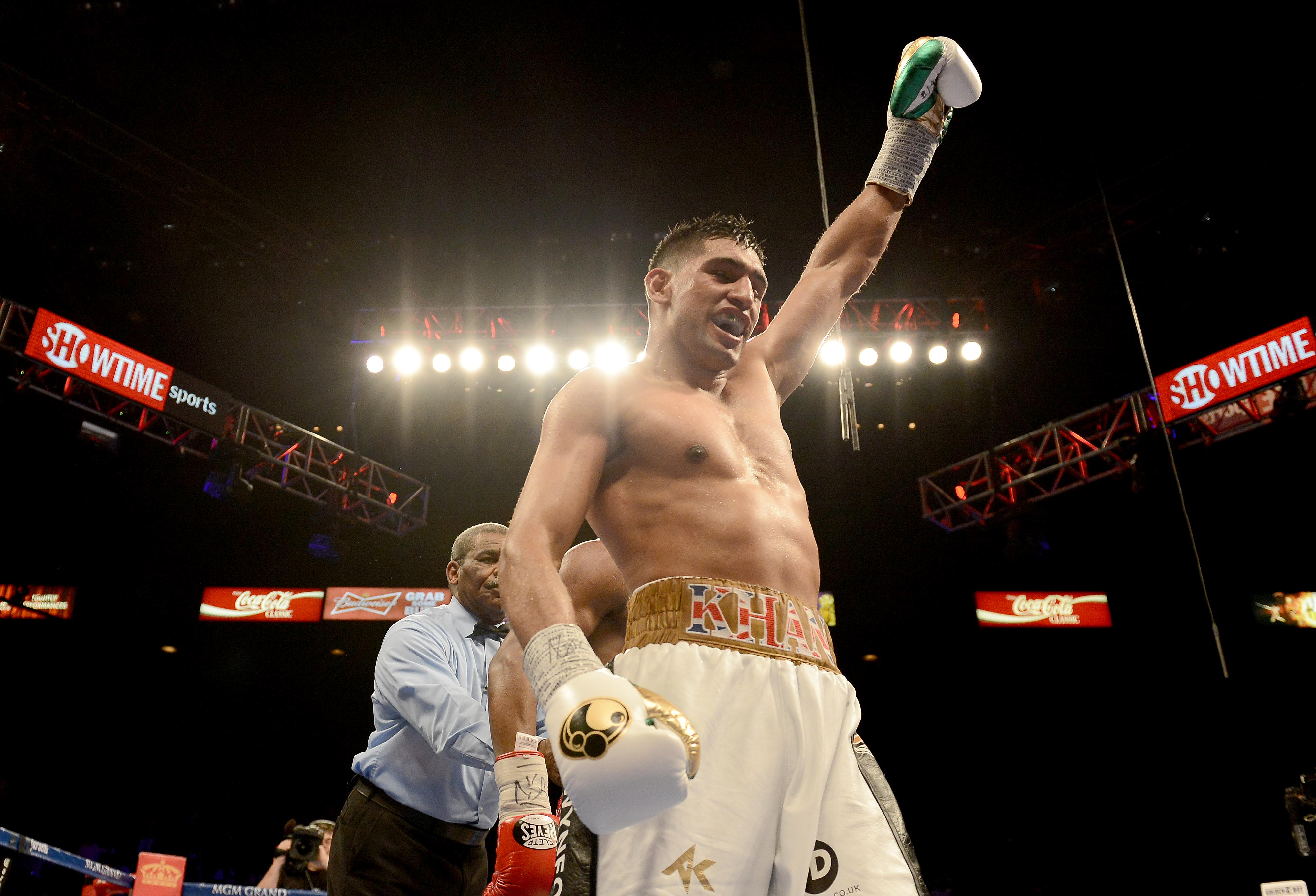 Amir Khan signs fight deal with Matchroom to end Eddie Hearn feud