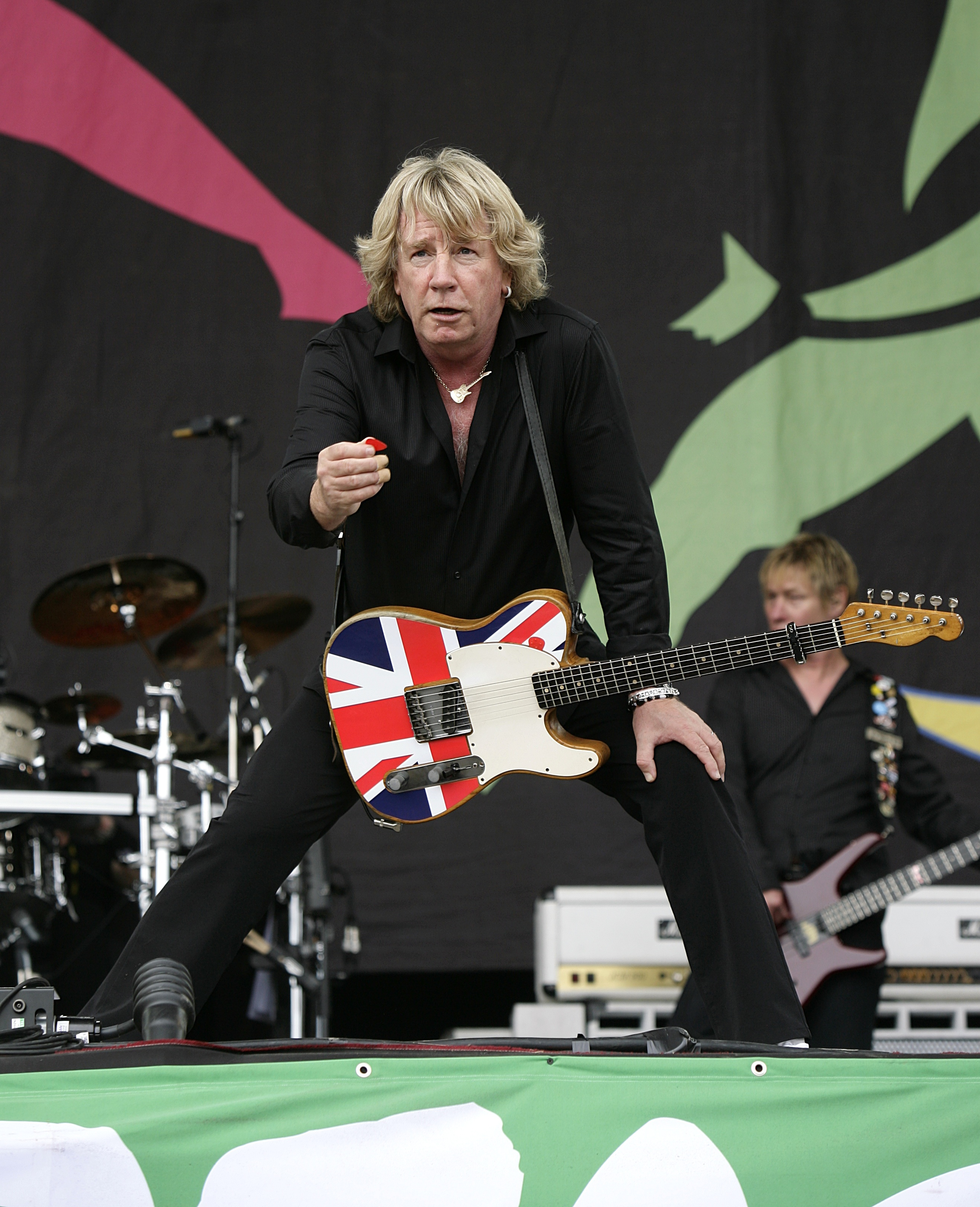 File photo datred 28/06/09 of Rick Parfitt of Status Quo performing during the 2009 Glastonbury Festival at Worthy Farm in Pilton, Somerset as he has died in hospital in Spain, his manager has said. PRESS ASSOCIATION Photo. Issue date: Saturday December 24, 2016. See PA story DEATH Parfitt. Photo credit should read: Yui Mok/PA Wire