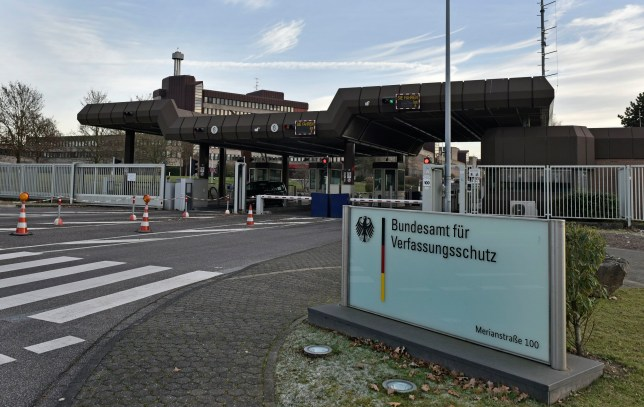 The entrance of the headquarters of the German domestic intelligence service, Bundesamt f¸r Verfassungsschutz, is pictured in Cologne, Germany, on Wednesday, Nov. 30, 2016. Germanyís domestic intelligence service says an employee suspected of trying to pass along sensitive material to Islamic extremists had only been working for the agency for a short time. (AP Photo/Martin Meissner)