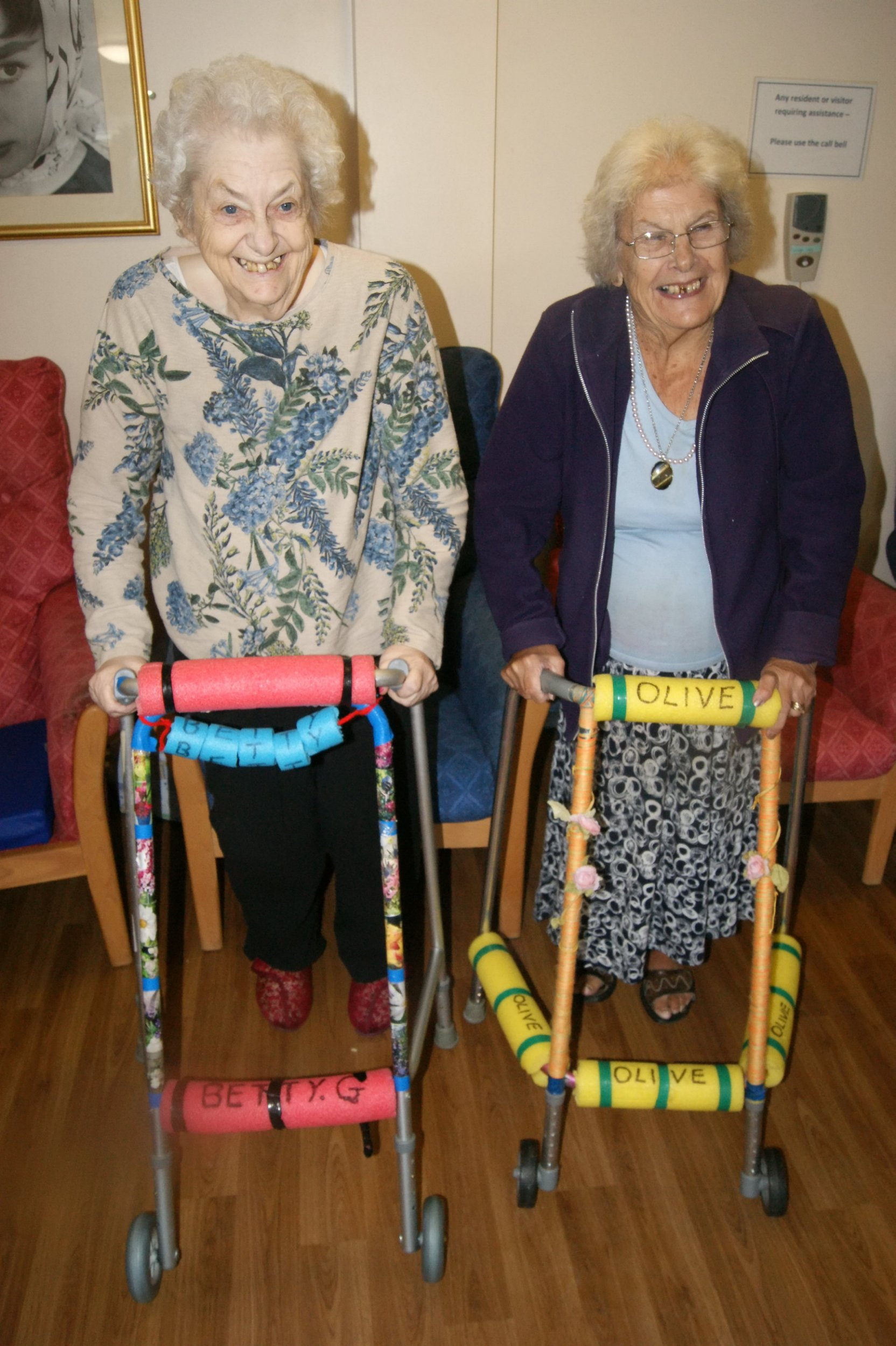 """Betty Gilvary, 80, (L) & Olive Fenner, 81, (R) with their zimmer frames. An ingenious campaign to 'pimp' pensioners' zimmerframes has led to an incredible 60 per cent reduction in falls. See MASONS story MNZIMMER. The """"Pimp My Zimmer"""" campaign was launched at several care homes in Essex a year ago by care home manager Angela Donlevy. She came up with the idea after wondering why all the frames were grey in a dream. Since then the numbers of falls at some of the homes run by Essex County Council has fallen by 60 per cent. The bright colours have proved invaluable to residents with dementia who previously struggled to recognise which frame was theirs."""