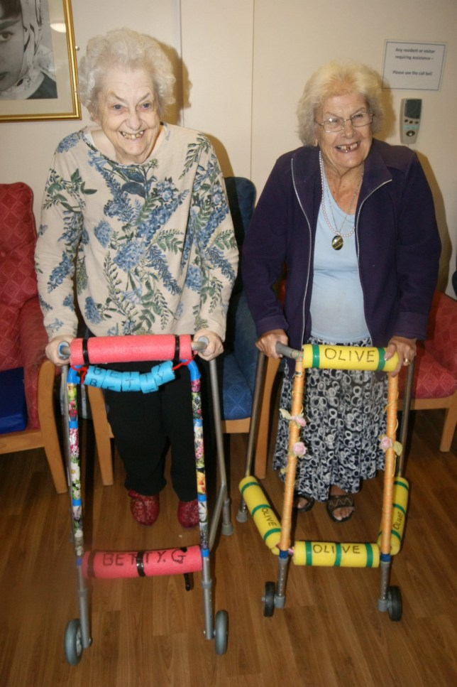 "Betty Gilvary, 80, (L) & Olive Fenner, 81, (R) with their zimmer frames. An ingenious campaign to 'pimp' pensioners' zimmerframes has led to an incredible 60 per cent reduction in falls. See MASONS story MNZIMMER. The ""Pimp My Zimmer"" campaign was launched at several care homes in Essex a year ago by care home manager Angela Donlevy. She came up with the idea after wondering why all the frames were grey in a dream. Since then the numbers of falls at some of the homes run by Essex County Council has fallen by 60 per cent. The bright colours have proved invaluable to residents with dementia who previously struggled to recognise which frame was theirs."