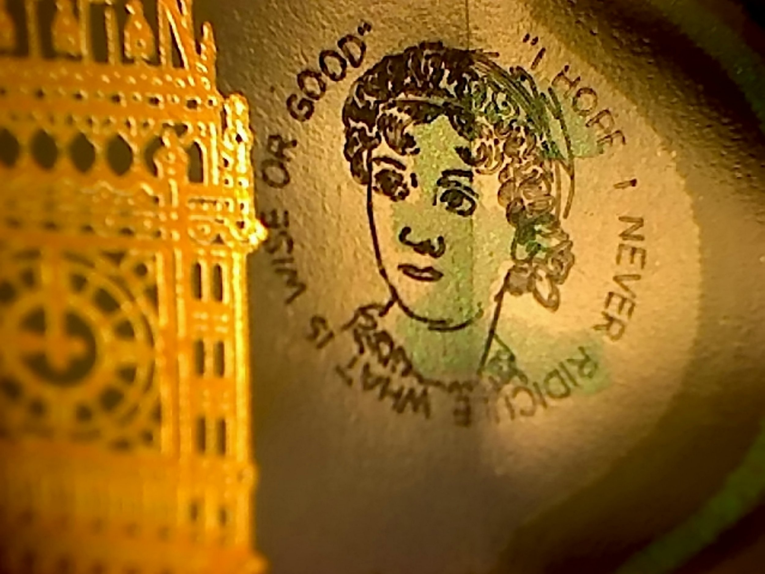 The Jane Austen portrait. Brits are being urged to check their new fivers after engraved bank notes worth as much as £50,000 were circulated in a Willie Wonka-style 'Golden Ticket' giveaway. See NTI story NTINOTE. Tiny portraits of Jane Austen have been added to four of the new £5 notes by talented micro-engraver Graham Short. The 70-year-old painstakingly carved tiny 5mm portraits of the novelist onto the polymer cash, next to the images of Sir Winston Churchill and Big Ben. Classic quotes from Emma, Pride and Prejudice, and Mansfield Park have also been engraved on to the Bank of England notes, which went into circulation last weekend. The outline of the golden engraving ise visible to the naked eye - but a microscope will be needed to see it properly. Art experts are estimating that the four fivers could be worth up to £50,000 after collectors forked out thousands to buy notes with unusual serial numbers.