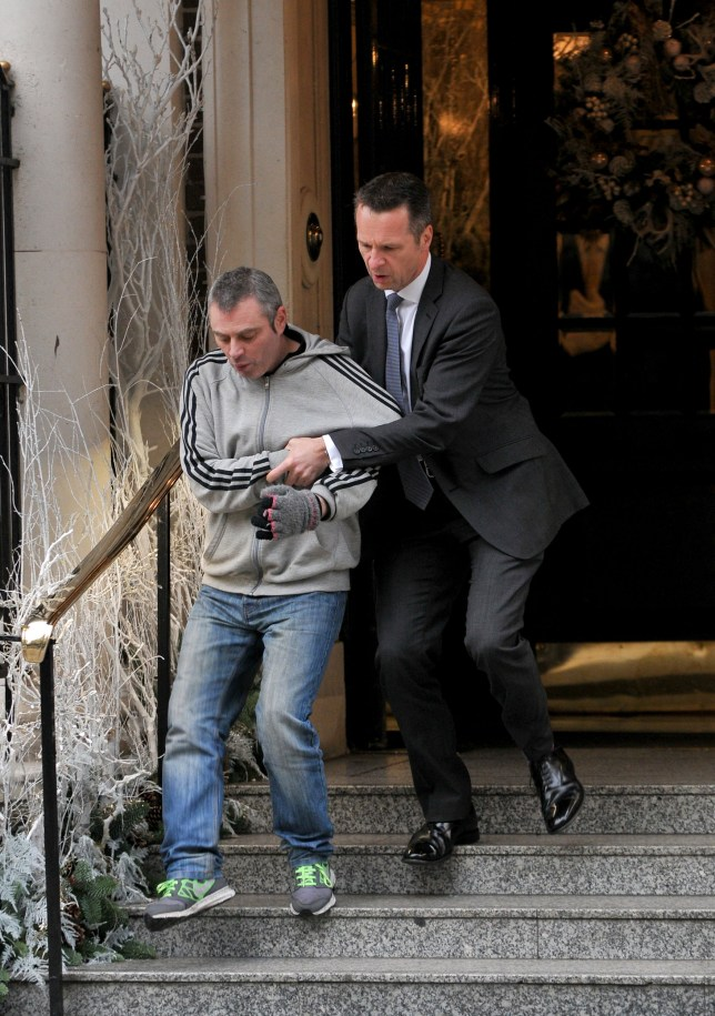 Kerry Davies/DAILY MAIL 6/12/2016 Picture shows:A royal detective drags a drunken Irish man out of the Goring Hotel after he was spotted acting erratically in the street where the Queens car was parked and rushed into the hotel.The Queen was in attendance for the yearly Christmas Lunch for her staff at the Goring Hotel, London.