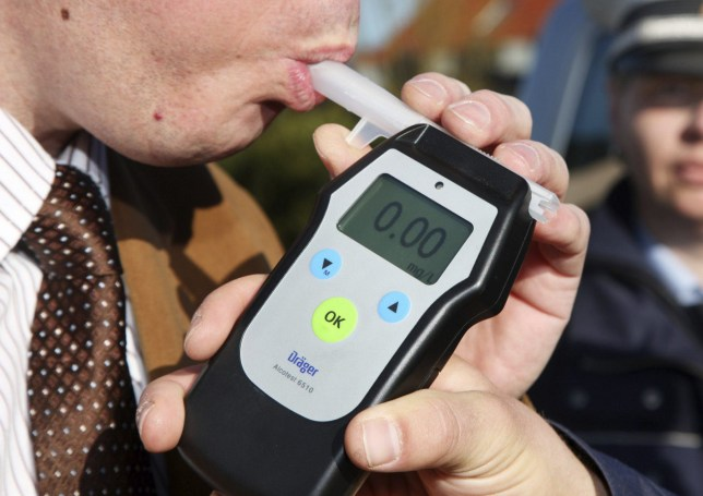 Mandatory Credit: Photo by imageBROKER/REX/Shutterstock (1858846a)nAlcohol breath test, driver being tested with a breathalyzer, breathalyser, Mettmann, North Rhine-Westphalia, Germany, EuropenVARIOUSnn