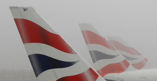 LONDON - DECEMBER 22: Tail fins of British Airways aircraft are seen through fog at Heathrow Airport on December 22, 2006 in London, England. A heavy cover of fog over London continues to cancel and delay flights at Heathrow Airport, causing disruption to many passenger's Christmas vacation travel arrangements. (Photo by Daniel Berehulak/Getty Images)