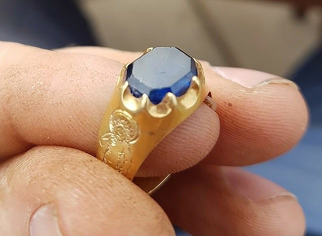 BNPS.co.uk (01202 558833) Pic: MarkThompson/BNPS A medieval ring found by an amateur treasure hunter in the heart of Robin Hood's Sherwood Forest could be worth up to £70,000. Mark Thompson, who makes his living spray-painting fork lift trucks, had been in the famous Nottinghamshire woodland for just 20 minutes when his metal detector sounded. The 34-year-old, who had only taken up the hobby 18 months before, was expecting to find something innocuous - perhaps some dropped money or rubbish left behind by holidaymakers. But as he shoveled away at the soil he saw a glint of gold, and after removing the surrounding dirt he uncovered an ornate piece of jewelry which appeared to be adorned with a precious sapphire.