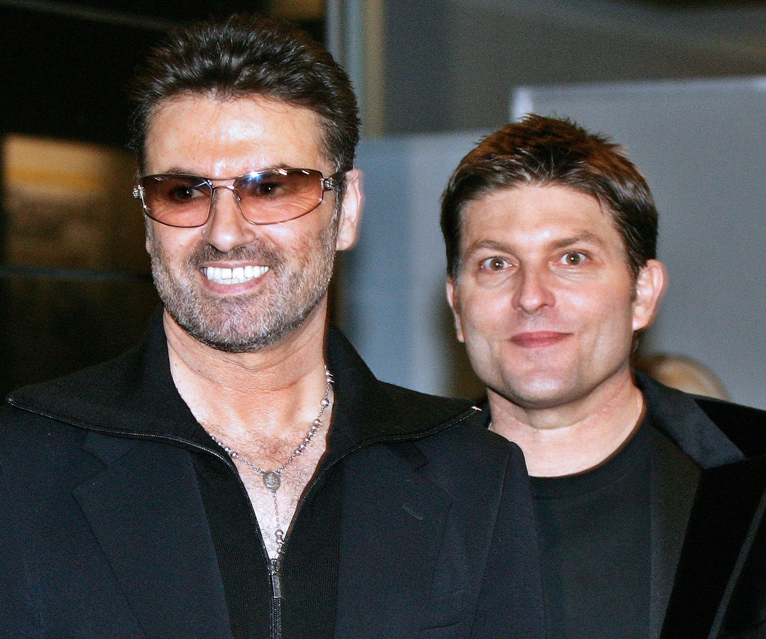 "(FILES) This file photo taken on December 15, 2005 shows British pop star George Michael (L) smiles with his partner Kenny Goss at a reception after the Japan premiere of his autobiographical movie ""George Michael, A Different Story"" at a restaurant in Tokyo. British pop singer George Michael, who rose to fame with the band Wham! and sold more than 100 million albums in his career, has died aged 53, his publicist said on December 25, 2016. / AFP PHOTO / --/AFP/Getty Images"