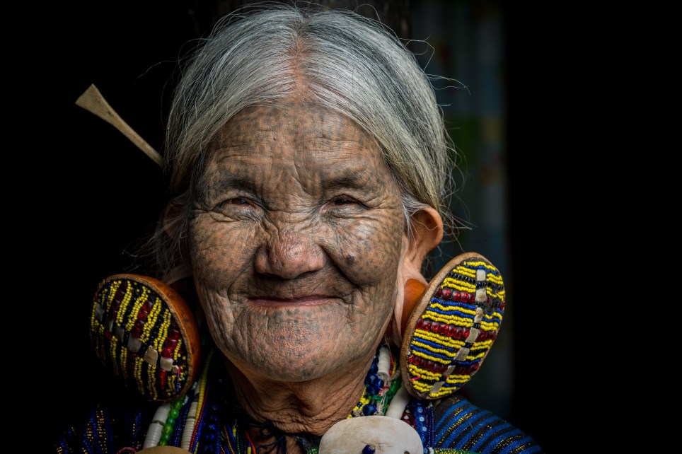 *** EXCLUSIVE *** MINDAT, MYANMAR - NOVEMBER 2016: Elder Chin tribe woman with face tattoos in, Mindat, Myanmar, November 2016. IN the mountains of Myanmar lives a tribe where the women have taken a unique approach to their beauty regime by decorating their faces with tattoos. The Chin people in the remote mountain town of Mindat, have been marking women in the area with intricate face tattoos for centuries. With a variety of styles and designs the detailed markings have a deep rooted cultural significance to the largely christian community. Photographer and cyber security expert, Teh Han Lin took the intimate pictures on a recent trip to Myanmar. PHOTOGRAPH BY Teh Han Lin / Barcroft Images London-T:+44 207 033 1031 E:hello@barcroftmedia.com - New York-T:+1 212 796 2458 E:hello@barcroftusa.com - New Delhi-T:+91 11 4053 2429 E:hello@barcroftindia.com www.barcroftimages.com