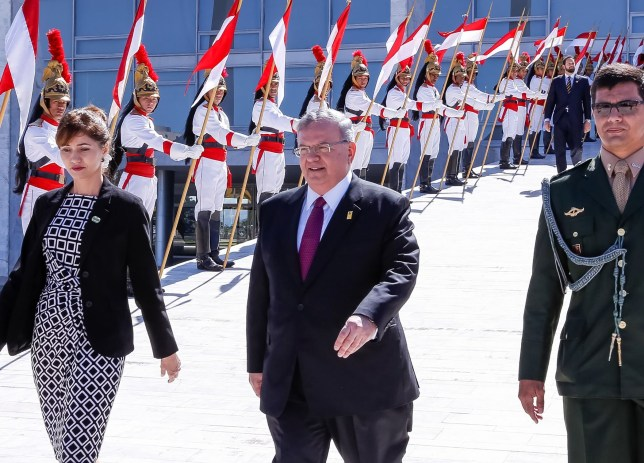 """Handout undated picture released the Brazilian presidency showing Greek ambassador to Brazil, Kyriakos Amiridis (C), leaving after presenting his credentials to Brazilian President Michel Temer during a ceremony in Brasilia on May 25, 2016. Amiridis was last seen on the night of December 26, 2016 near Rio de Janeiro while vacationing with his family and has since been missing, police said on December 29. """"A case has been opened to investigate the ambassador's disappearance,"""" Rio state police said in a statement. / AFP PHOTO / BRAZILIAN PRESIDENCY / Marcos CORREA / RESTRICTED TO EDITORIAL USE - MANDATORY CREDIT """"AFP PHOTO / BRAZILIAN PRESIDENCY / MARCOS CORREA"""" - NO MARKETING NO ADVERTISING CAMPAIGNS - DISTRIBUTED AS A SERVICE TO CLIENTS MARCOS CORREA/AFP/Getty Images"""