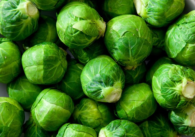 A dish full of uncooked, unpeeled Brussels sprouts. Natural, soft lighting. Credit: Getty Images