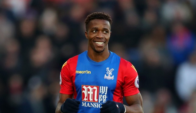SWANSEA, WALES - NOVEMBER 26: Wilfried Zaha of Crystal Palace celebrates scoring the opening goal during the Premier League match between Swansea City and Crystal Palace at Liberty Stadium on November 26, 2016 in Swansea, Wales. (Photo by Christopher Lee/Getty Images)