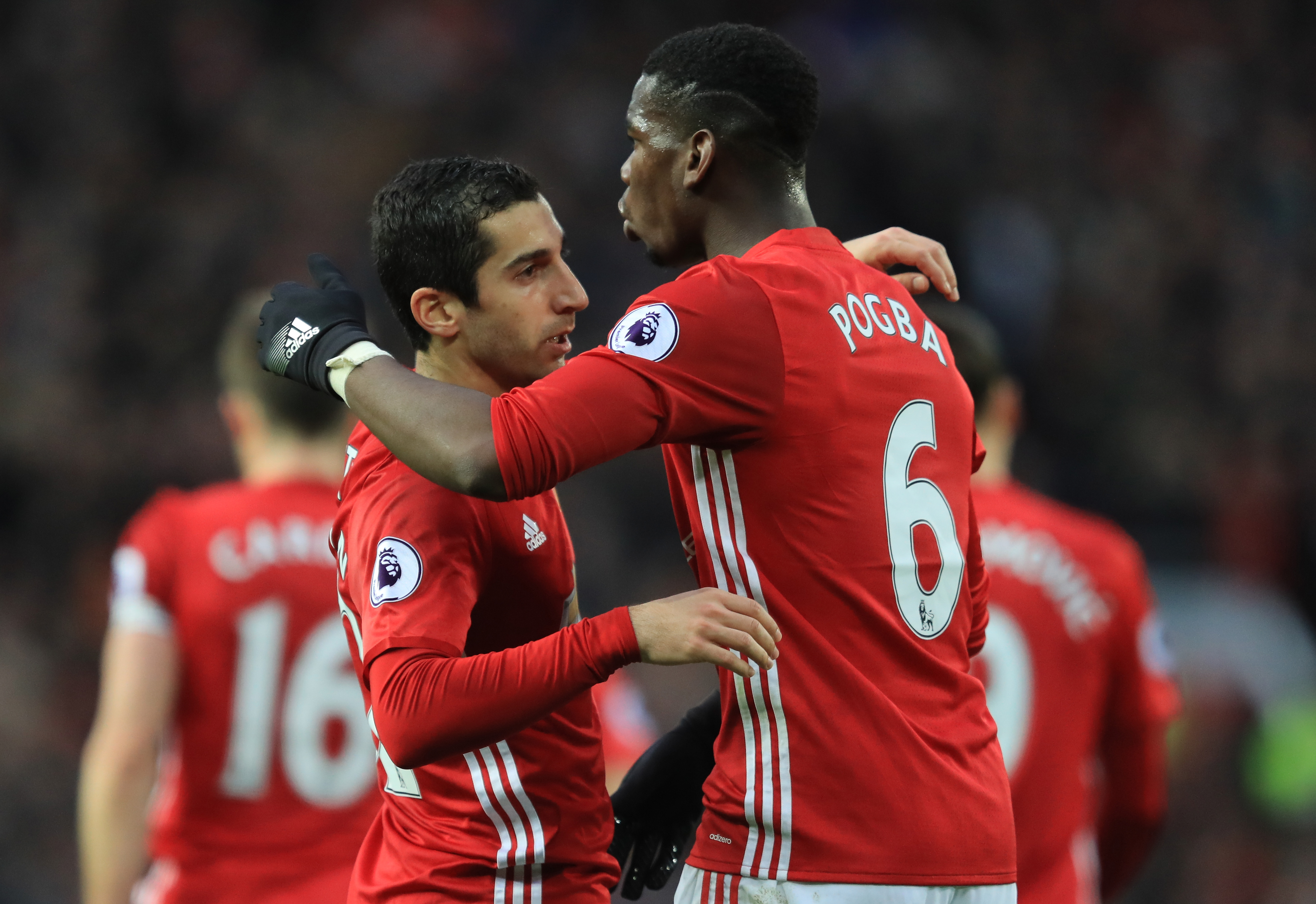 MANCHESTER, ENGLAND - DECEMBER 11:  Henrikh Mkhitaryan (L) of Manchester United celebrates scoring the opening goal with his team mate Paul Pogba (R) during the Premier League match between Manchester United and Tottenham Hotspur at Old Trafford on December 11, 2016 in Manchester, England.  (Photo by Richard Heathcote/Getty Images)