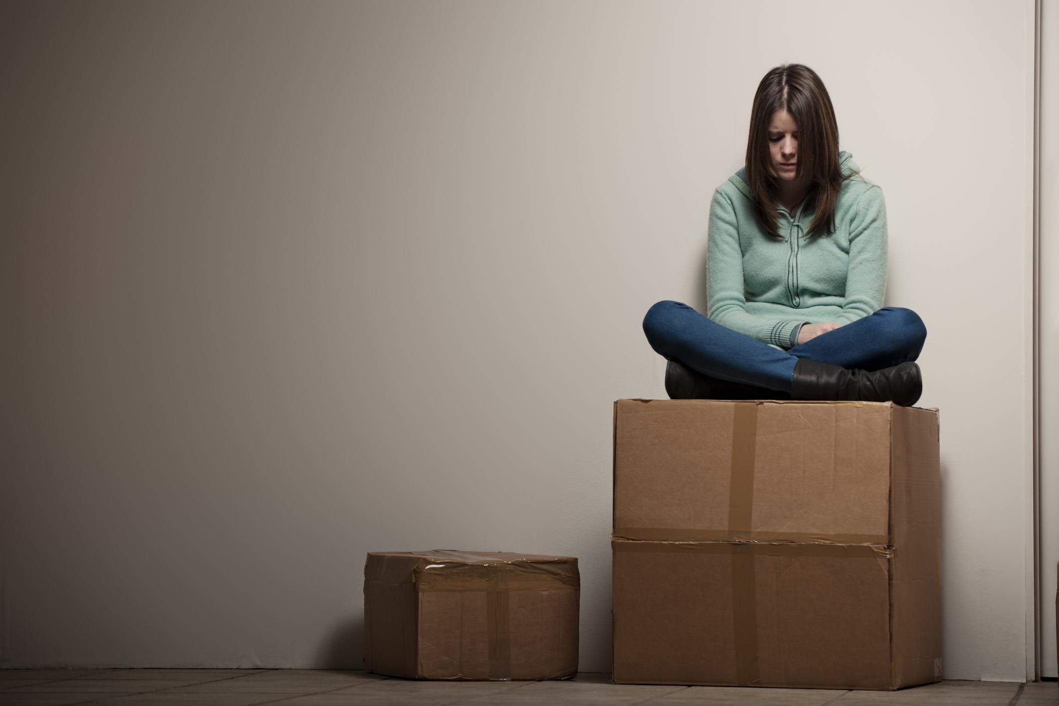 woman sitting on box