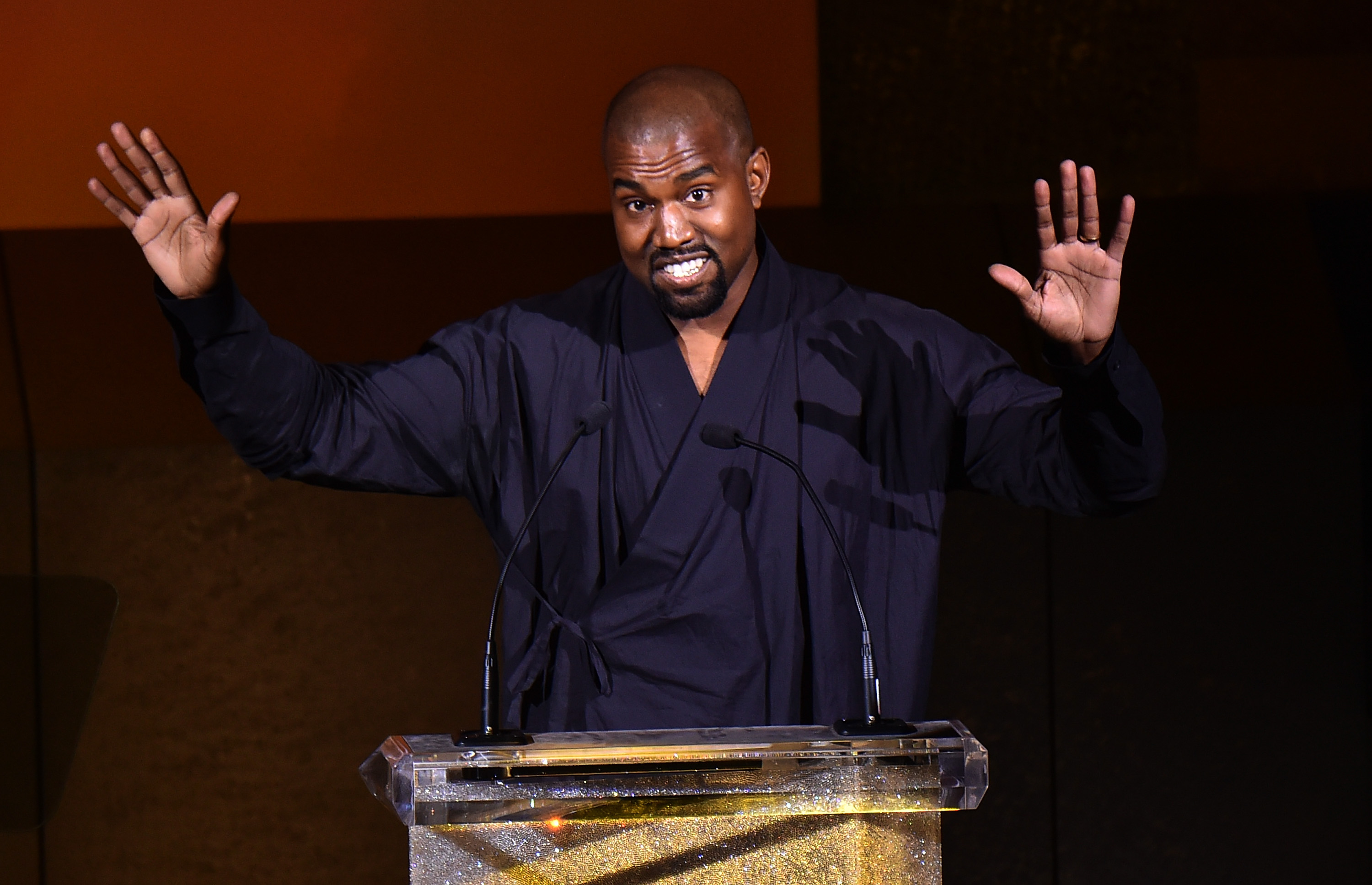 NEW YORK, NY - JUNE 01: Kanye West presents the Fashion Icon Award to Pharrell Williams onstage at the 2015 CFDA Fashion Awards at Alice Tully Hall at Lincoln Center on June 1, 2015 in New York City. (Photo by Michael Loccisano/Getty Images)