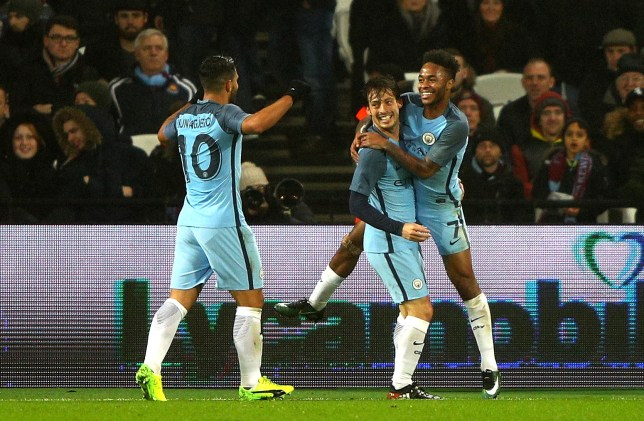 LONDON, ENGLAND - JANUARY 06: David Silva of Manchester City celebrates scoring his sides third goal with Raheem Sterling of Manchester City during The Emirates FA Cup Third Round match between West Ham United and Manchester City at London Stadium on January 6, 2017 in London, England. (Photo by Ian Walton/Getty Images)