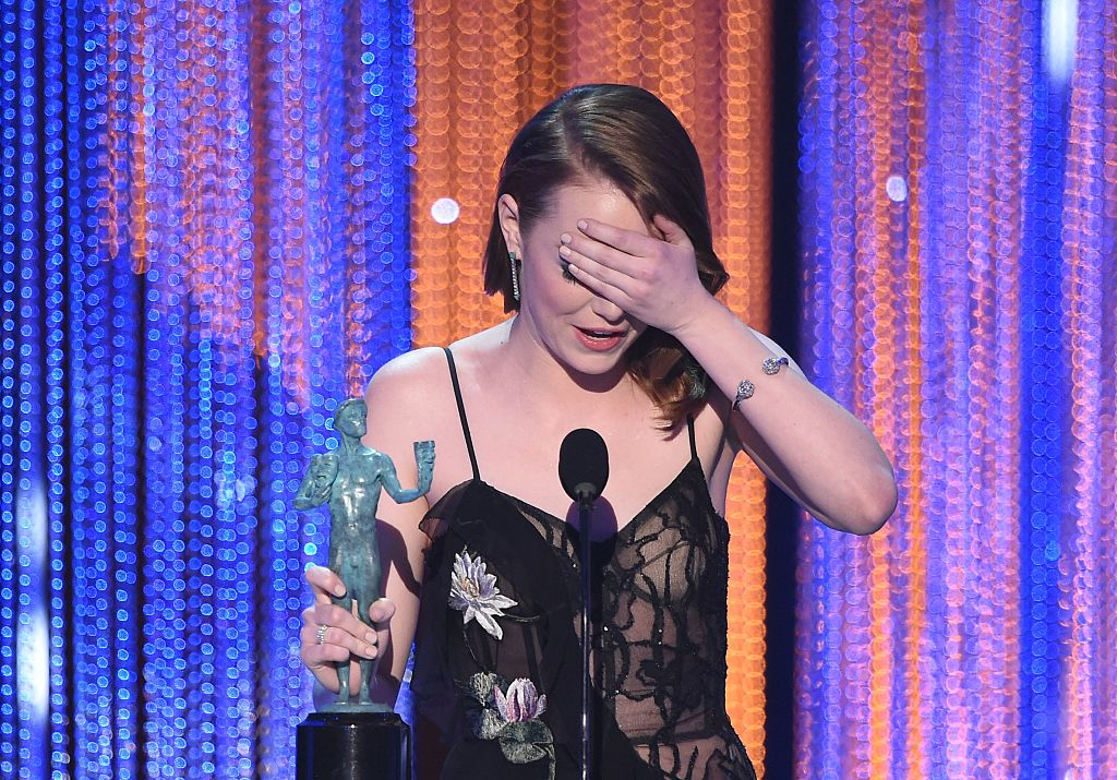 Actress Emma Stone accepts the award for best leading actress for 'La LA Land' during the 23rd Annual Screen Actors Guild Awards show at The Shrine Auditorium on January 29, 2017 in Los Angeles, California. / AFP / Robyn BECK (Photo credit should read ROBYN BECK/AFP/Getty Images)