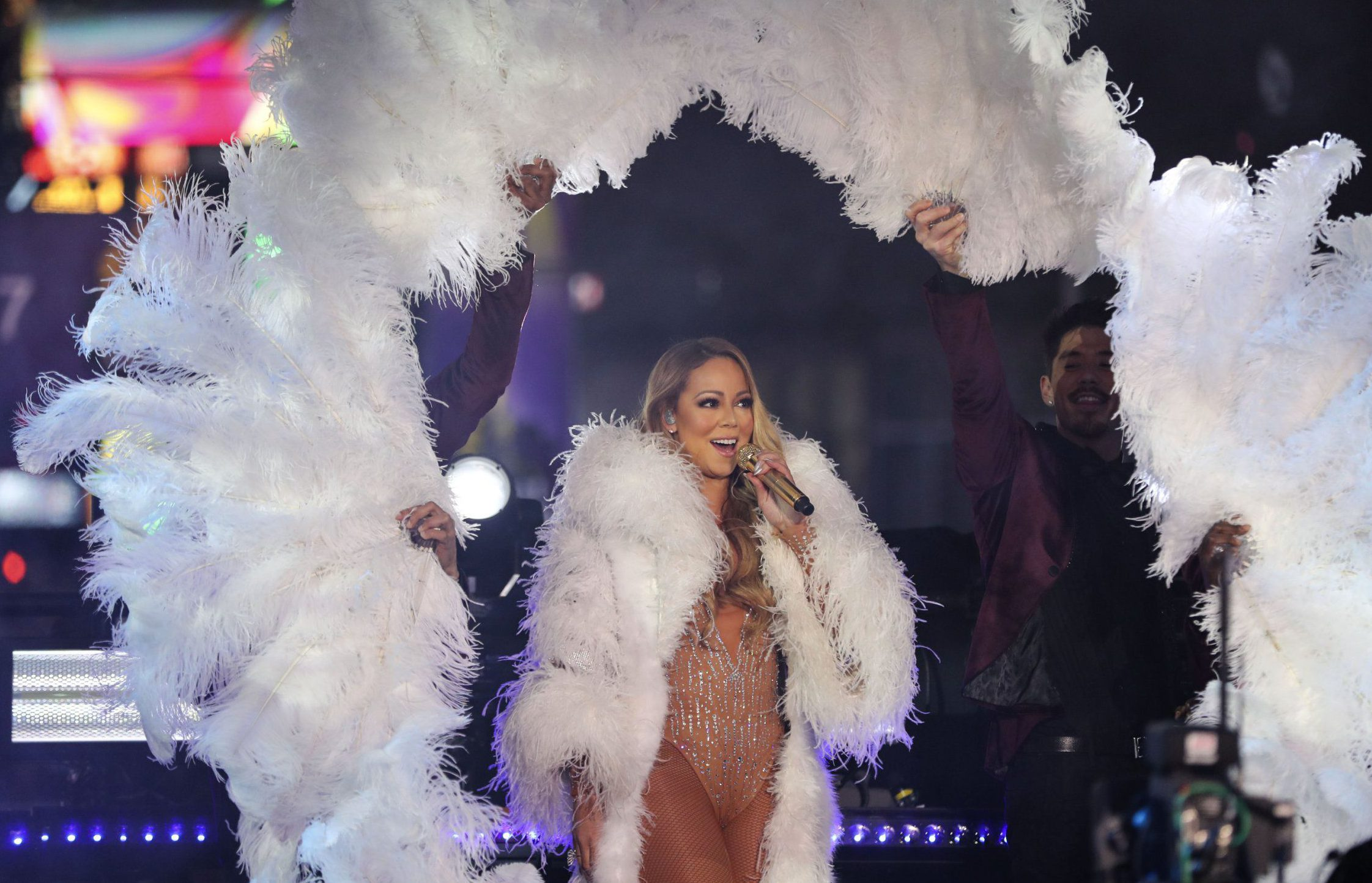 Mandatory Credit: Photo by Xinhua/REX/Shutterstock (7688459m) Singer Mariah Carey performs during the New Year celebration at Times Square in New York New Year celebrations, New York, USA - 31 Dec 2016 The New Year celebration was held at Times Square from the night of Dec. 31, 2016 to Jan. 1, 2017, a well-known traditional event which is expected to draw hundreds of spectators from the Untied States and other parts of the world.
