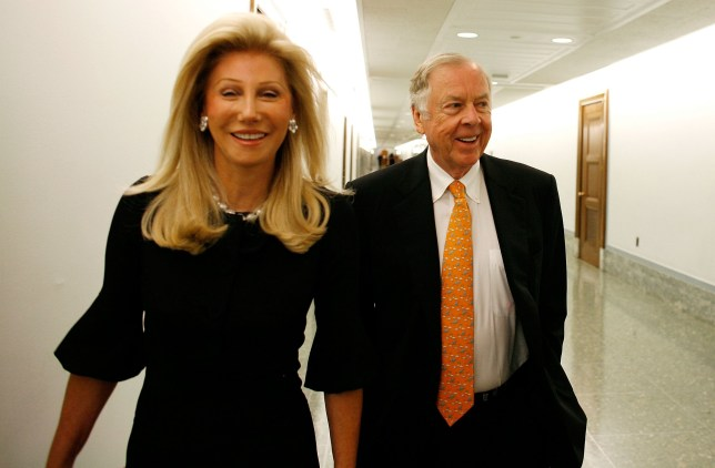 WASHINGTON - JULY 22: Oil billionaire T. Boone Pickens (R) and his wife Madeleine Pickens arrive at the Dirksen Senate Office Building ahead of testifiying before the Senate Homeland Security and Governmental Affairs Committee about alternative energy plans on Capitol Hill July 22, 2008 in Washington, DC. After making billions of dollars as an oil speculator, Pickens wants to promote the use of American technology -- including wind turbines -- and alternative energy to reduce the U.S. dependency on foreign oil. (Photo by Chip Somodevilla/Getty Images)