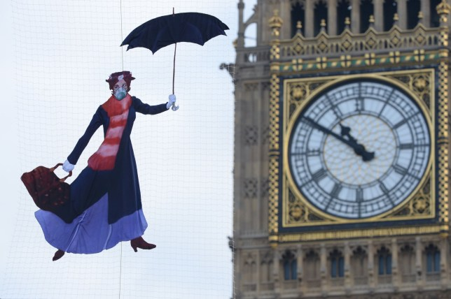 A drawing of Mary Poppins wearing a pollution mask is suspended in front of the Queen Elizabeth Tower at the Palace of Westminster by Greenpeace campaigners after it was revealed that legal air pollution limits for the whole year have been broken just five days into 2017. PRESS ASSOCIATION Photo. Picture date: Friday January 6, 2017. See PA story ENVIRONMENT Pollution. Photo credit should read: Victoria Jones/PA Wire