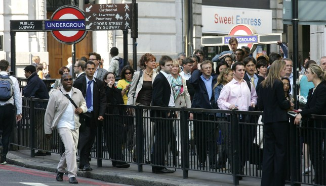 "Commuters walk past Monument Underground Station after subway and bus lines were closed after terrorist attacks in London 07 July 2005. Explosions ripped through three underground trains and a bus in London Thursday, killing at least 33 people and injuring more than 340 in a wave of ""terrorist attacks"" a day after the capital won its bid to host the 2012 Olympic Games and as G8 leaders met in Scotland. (Photo credit should read PACO SERINELLI/AFP/Getty Images)"