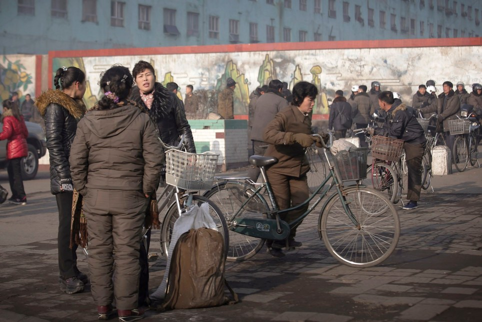 North Koreans gather at a square on Chollima district Saturday, Jan. 7, 2017, in Nampo, North Korea. Nampo is a city and seaport located on the west coast of North Korea. (AP Photo/Wong Maye-E)