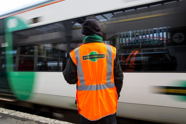 LONDON, ENGLAND - OCTOBER 18: A Southern rail conductor looks on as a Southern rail train leaves East Croydon station on October 18, 2016 in London, England. Staff at Southern rail have begun a second three-day strike over plans for drivers, instead of conductors, to operate train doors. The action will see hundreds of trains cancelled and other services affected as a result. (Photo by Jack Taylor/Getty Images)