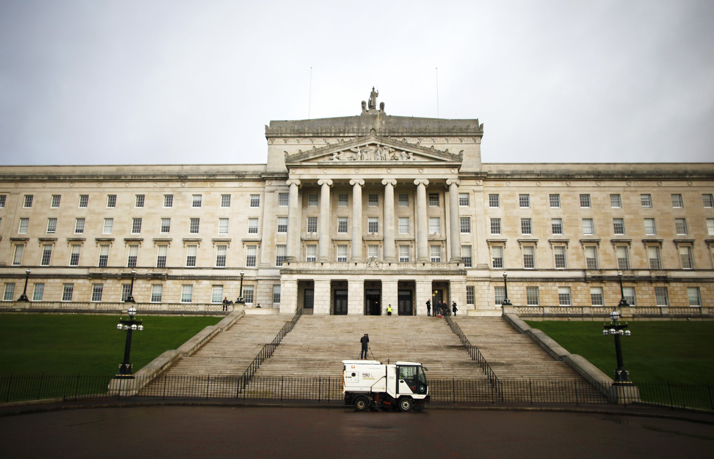 A road sweeper van passes Stormont, Belfast, Northern Ireland, Monday, Jan. 16, 2017. The Northern Ireland Assembly faces likely dissolution for an election that could make revival of a Catholic-Protestant government more difficult following the recent resignation by Martin McGuinness. (AP Photo/Peter Morrison)