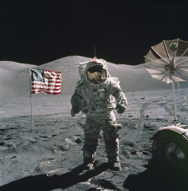 epa05722368 A handout photo made available by the NASA space agency on 16 January 2017 shows Apollo 17 Mission Commander Eugene A. Cernan standing near the lunar rover and an US flag during a spacewalk on the moon, 12 December 1972. Eugene Cernan, the last man who walked on the moon, died on 16 January 2017 at the age of 82 according to NASA. EPA/NASA HANDOUT HANDOUT EDITORIAL USE ONLY/NO SALES