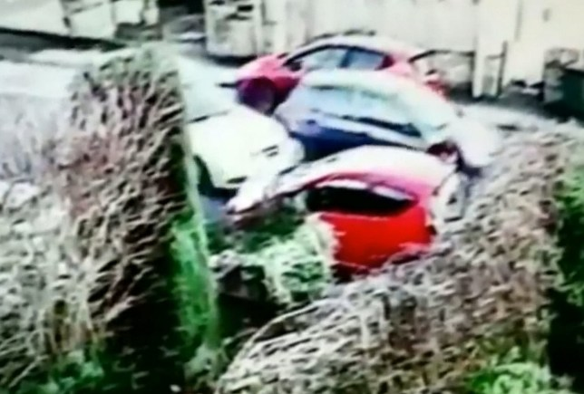Video grab of the dramatic moment Helen Wilson was hit by the car when it skidded into her on black ice. A grandma has spoken of her ëmiraculousí escape after coming inches from death outside her motherís home. See ROSS PARRY story RPYMIRACLE. Helen Wilson from Bradford, was knocked off her feet by a driver who is thought to have lost control on black ice on Tuesday morning. And while Mrs Wilsonís car had its front end torn off in the impact, she escaped the collision with bruising and ripped jeans.
