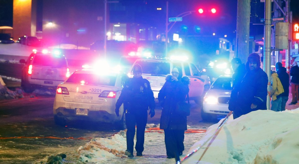 Police officers are seen near a mosque after a shooting in Quebec City, January 29, 2017. REUTERS/Mathieu Belanger TPX IMAGES OF THE DAY