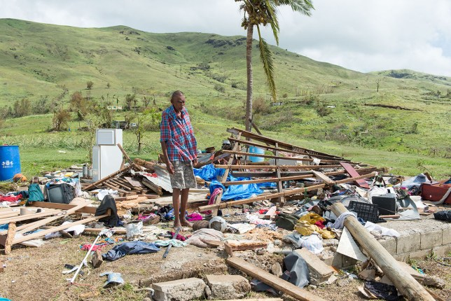 Naresh Kumar of Tuvu Lautoka looks at the remains of his house after it was destroyed by Cyclone Winston in Tuvu Lautoka (Picture: Getty Images)