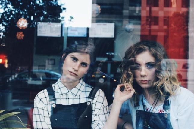 Two teenage girls looking moody
