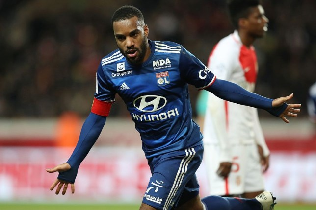 Lyon's French forward Alexandre Lacazette celebrates after scoring a goal during the French L1 football match between AS Monaco and Lyon at the Louis II Stadium in Monaco on December 18, 2016. / AFP / VALERY HACHE (Photo credit should read VALERY HACHE/AFP/Getty Images)
