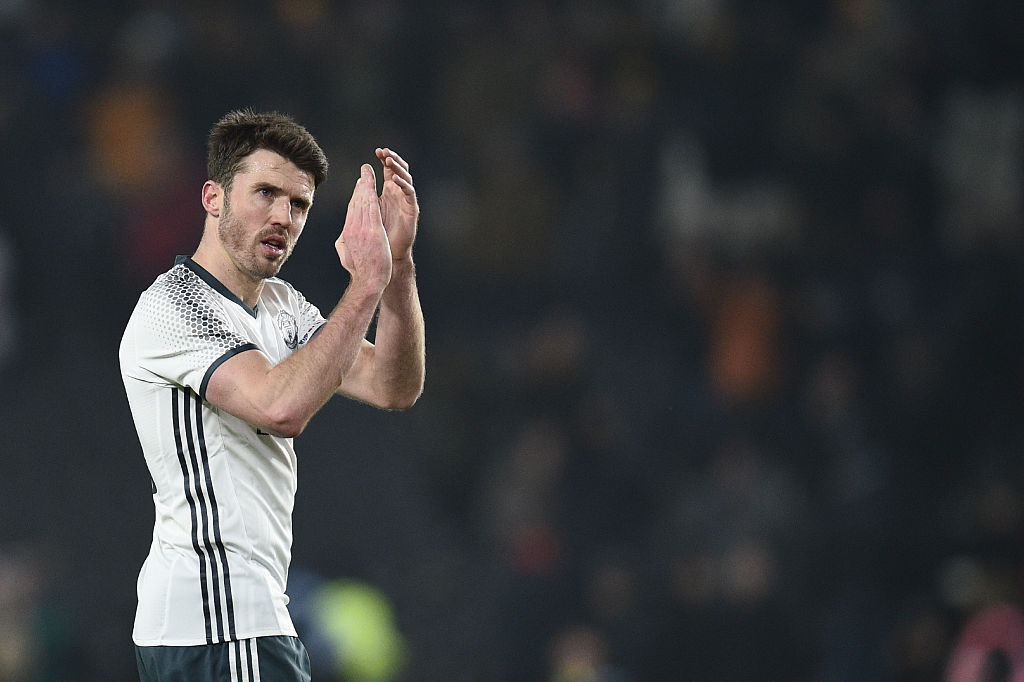 Manchester United's English midfielder Michael Carrick claps after winning the EFL (English Football League) Cup semi-final second-leg football match between Hull City and Manchester United at the KCOM Stadium in Kingston upon Hull, north east England on January 26, 2017. / AFP / Oli SCARFF / RESTRICTED TO EDITORIAL USE. No use with unauthorized audio, video, data, fixture lists, club/league logos or 'live' services. Online in-match use limited to 75 images, no video emulation. No use in betting, games or single club/league/player publications. / (Photo credit should read OLI SCARFF/AFP/Getty Images)