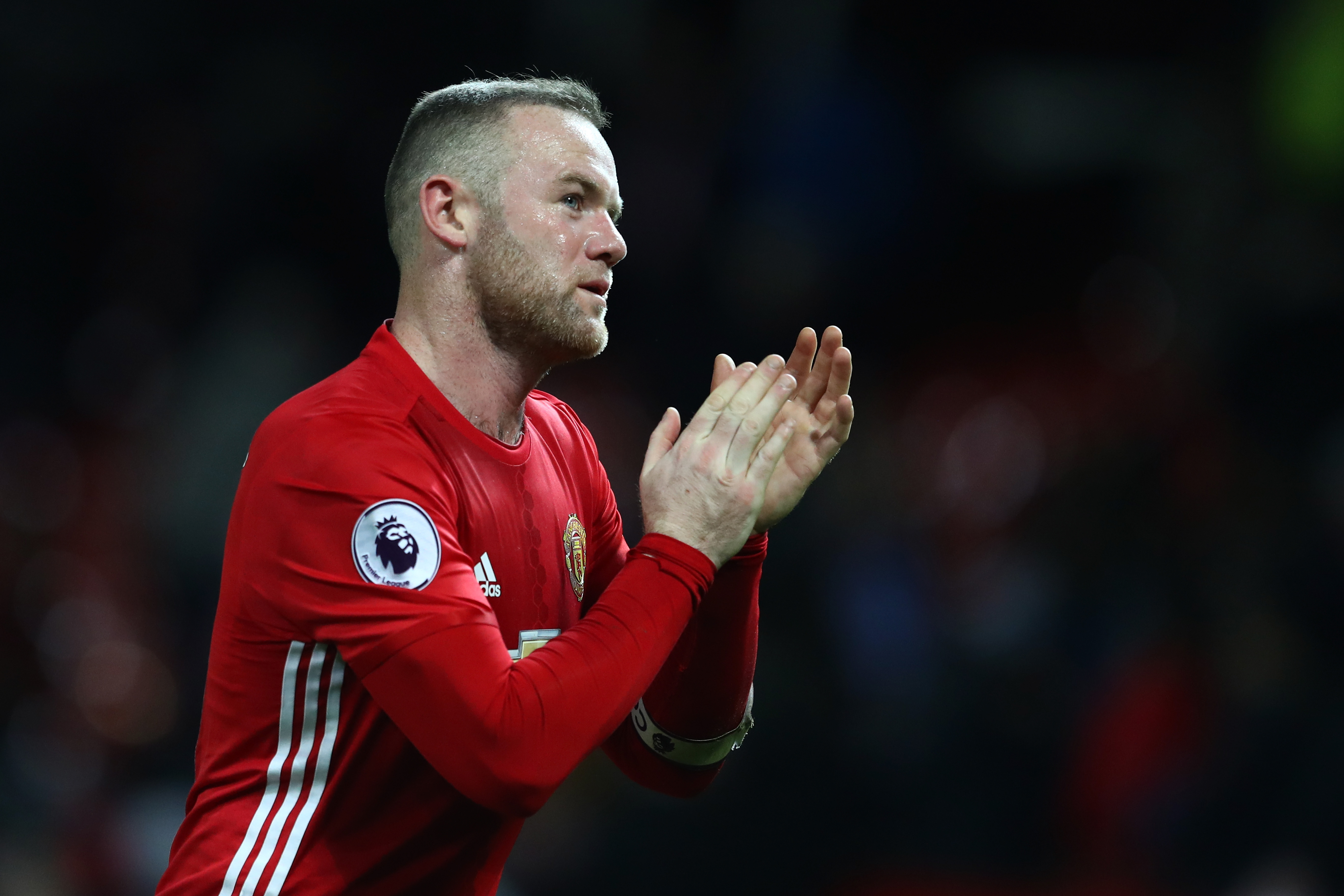 MANCHESTER, ENGLAND - FEBRUARY 01: Wayne Rooney of Manchester United applauds supporters during the Premier League match between Manchester United and Hull City at Old Trafford on February 1, 2017 in Manchester, England. (Photo by Clive Mason/Getty Images)