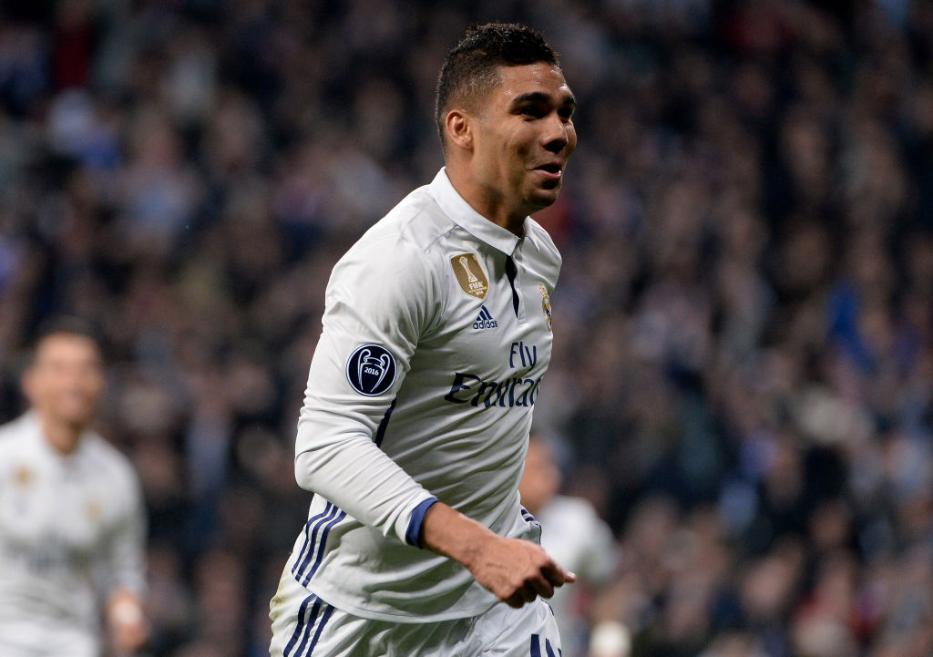 MADRID, SPAIN - FEBRUARY: Casemiro, #14 of Real Madrid celebrates after scoring his team's third goal during the UEFA Champions League Round of 16 first leg match between Real Madrid CF and SSC Napoli at Santiago Bernabeu on February 15, 2017 in Madrid, Spain. (Photo by Sonia Canada/Getty Images)