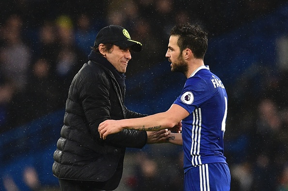 Chelsea's Italian head coach Antonio Conte (L) shakes hands with Chelsea's Spanish midfielder Cesc Fabregas (R) on the pitch at the end of the English Premier League football match between Chelsea and Swansea at Stamford Bridge in London on February 25, 2017. / AFP / Glyn KIRK / RESTRICTED TO EDITORIAL USE. No use with unauthorized audio, video, data, fixture lists, club/league logos or 'live' services. Online in-match use limited to 75 images, no video emulation. No use in betting, games or single club/league/player publications.  /         (Photo credit should read GLYN KIRK/AFP/Getty Images)