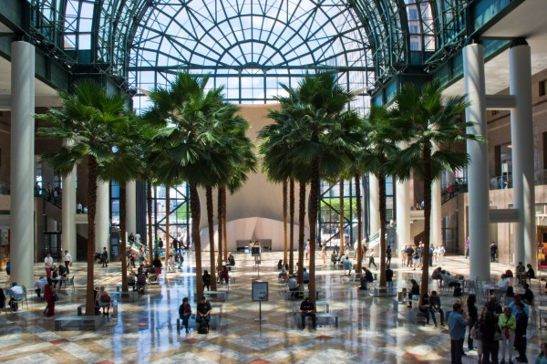People walk through the central atrium at the shopping mall at Brookfield Place, originally known as the World Financial Center, a complex of office buildings across from the World Trade Center site, New York City.